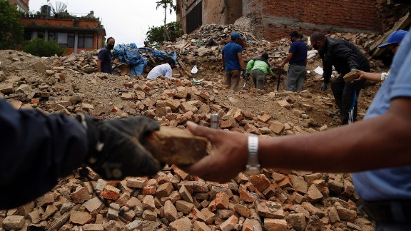 People collect bricks from the ruins of buildings in Bhaktapur, Nepal, on Friday, May 15. The region was struck with a magnitude-7.3 earthquake on Tuesday, May 12, just 17 days after a magnitude-7.8 quake left thousands dead.