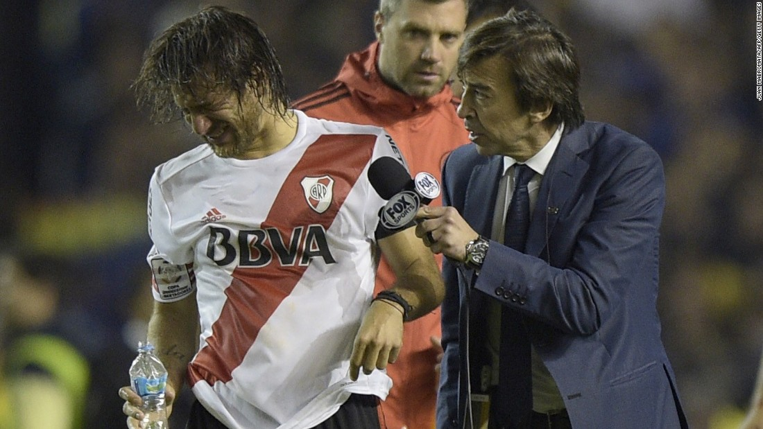 Midfielder Leonardo Ponzio was approached by a commentator on the pitch as he tried to wash out his eyes.