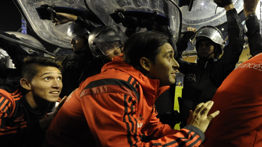 River players had to leave the pitch under police shields after the match as Boca fans threw objects at them.