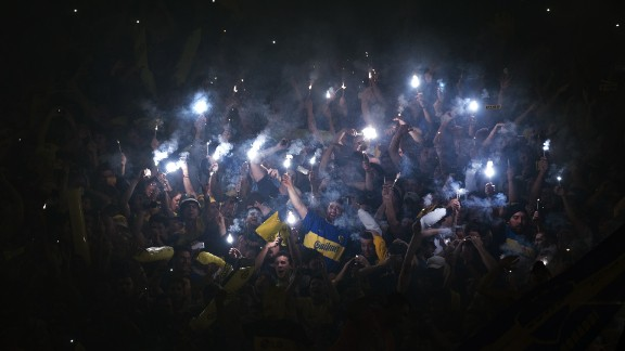 The Copa Libertadores round of 16 match between Boca Juniors and River Plate was suspended Thursday after Boca fans sprayed River players with an unknown irritant substance before the start of the second half.