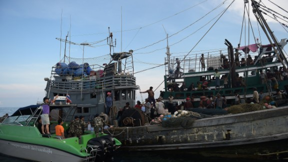 Fishermen and National Park officials provide food supplies to Rohingya migrants stranded on the boat. An Indonesian spokesman said on Wednesday, May 13, that provisions had been given to a migrant boat in the Strait of Malacca before the boat carried on its way to Malaysia -- purportedly the boat's intended destination.
