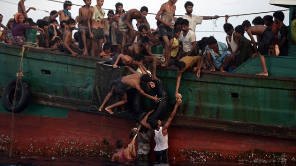 Rohingya migrants pass food supplies dropped by a Thai army helicopter to others aboard the boat. The Indonesian spokesman said Indonesia was currently providing food and shelter to 582 migrants rescued on May 10 and was working with international bodies to provide them documentation and temporary relocation.