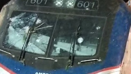 The windshield of the train may have been hit by something before the crash.  The area of interest is the circular mark on the right side of the windshield.