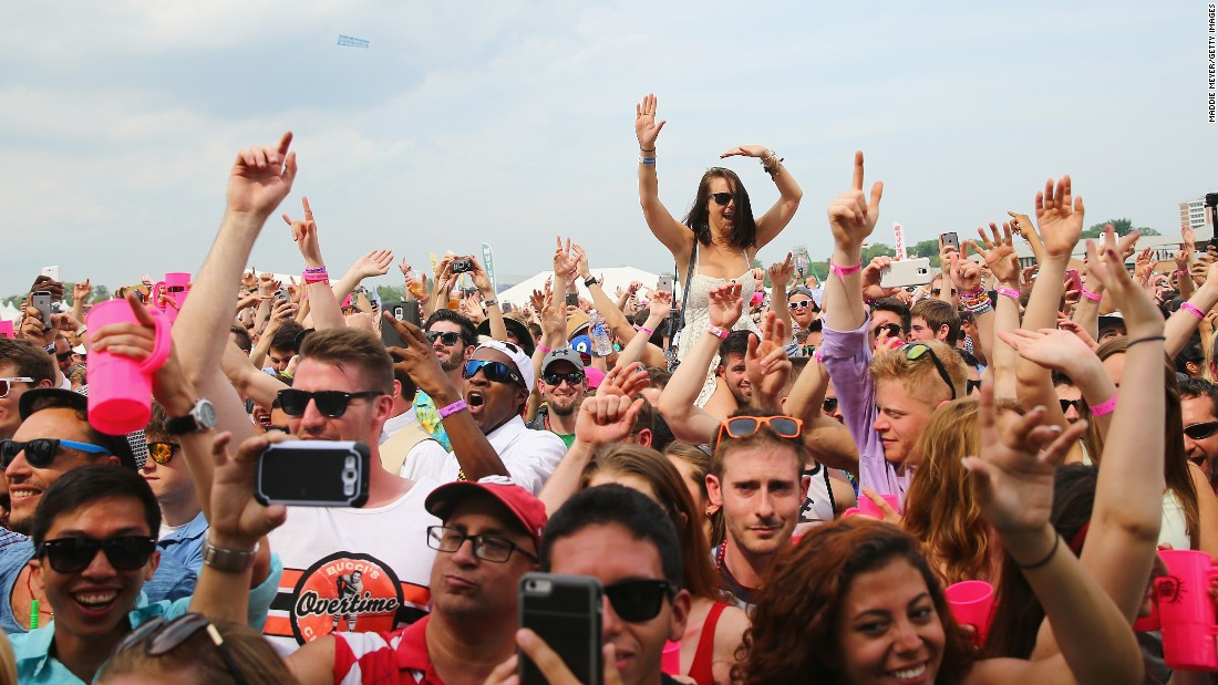 Concertgoers dance to Armin van Buuren in the infield prior to the Preakness.