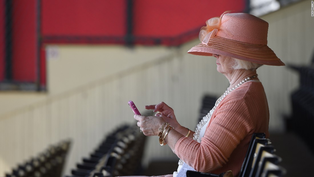 Sandy Wiebel, of Boonsboro, Maryland, looks over her phone in the stands.