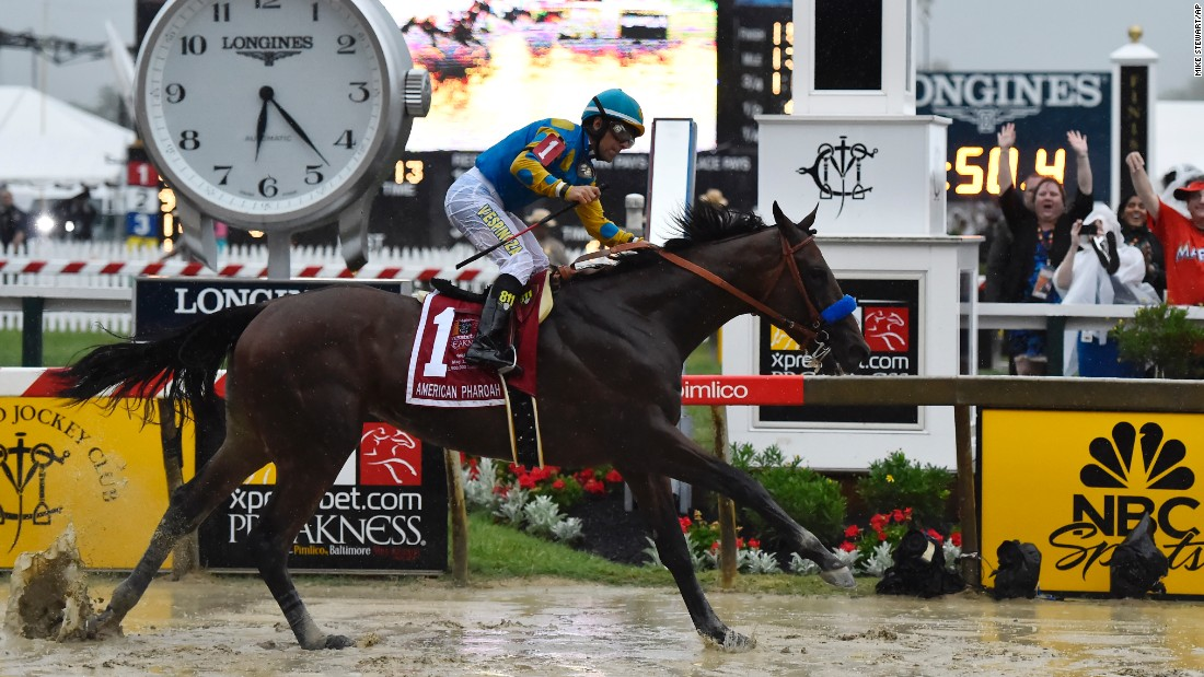 American Pharoah, ridden by Victor Espinoza, wins the Preakness Stakes to continue its quest for the coveted Triple Crown.