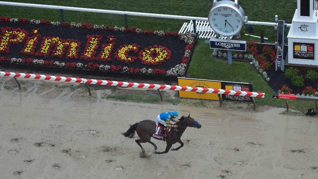 American Pharoah crossing the finish line to win the Preakness Stakes. With a win in the Belmont Stakes in New York on June 6, American Pharoah would become the first horse since Affirmed in 1978 to take the Triple Crown.