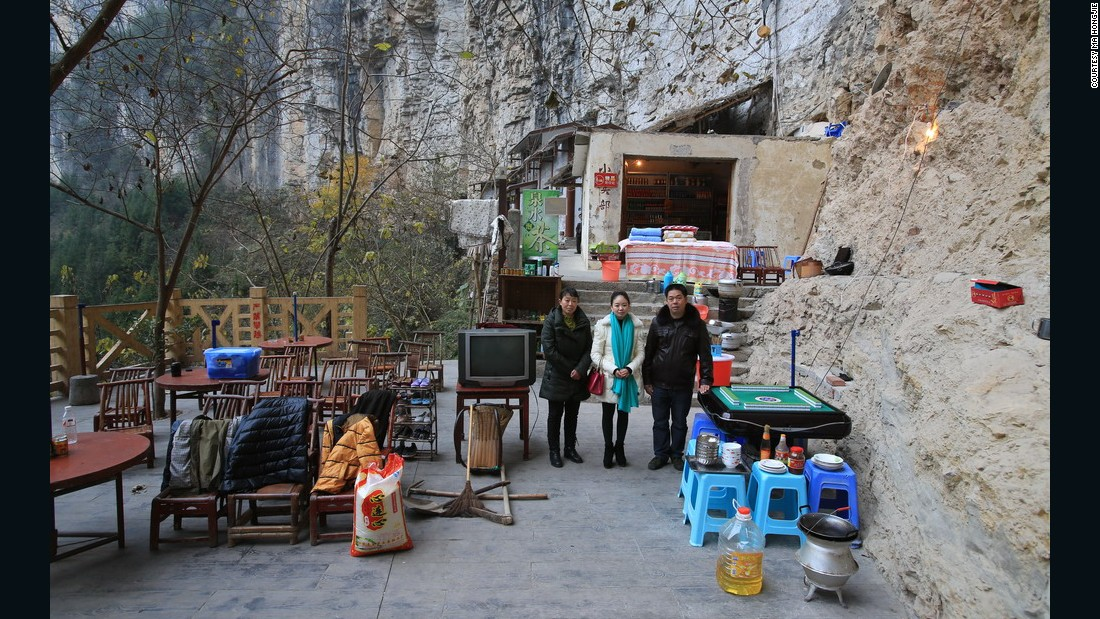 Zhang Jian and his wife live in a sinkhole, in Xiaozhai Village, Fengjie County in Chongqing. The Fengjie Sinkhole is one of the largest sinkholes in the world. In 1991, Zhan Jian was given the job of monitoring the water level of the river, so he moved to his new home inside the sinkhole.<br />