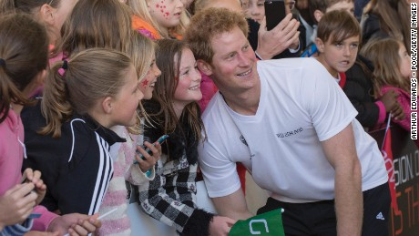 Prince Harry greets admirers in Auckland, New Zealand, on May 16.