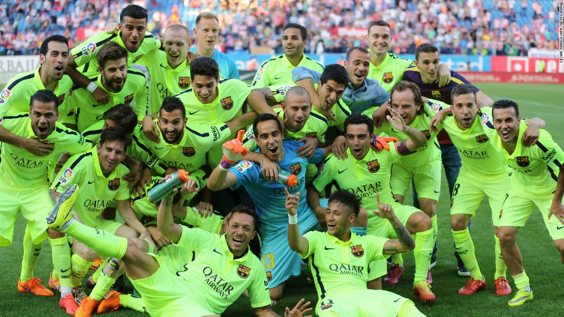 Barcelona players celebrate clinching the La Liga title on the Vicente Calderon pitch.