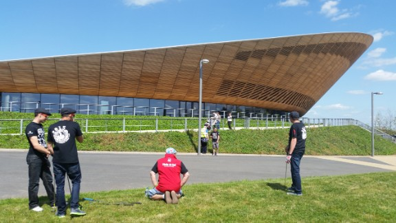 The Olympic Velodrome served as the backdrop for the first tee.