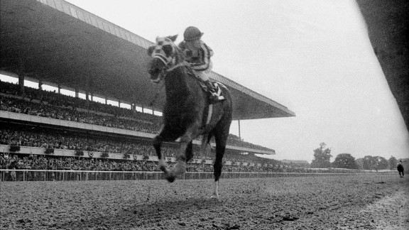 Secretariat races toward the finish line, blowing away the field in record time to win the Belmont Stakes in June 1973. With the victory, Secretariat became the first horse to win the Triple Crown since Citation in 1948. The Triple Crown was won two other times in the '70s, by Seattle Slew in 1977 and Affirmed in 1978. In 2015, American Pharoah became the first horse to take the Triple Crown in 37 years.