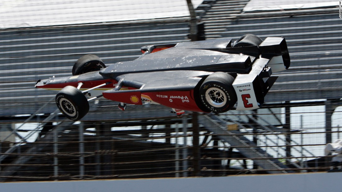 "The car driven by Helio Castroneves goes airborne Wednesday, May 13, during a practice run for the Indianapolis 500. Castroneves was not hurt in the wreck. ""I just brushed the wall, and unfortunately the car just took off,"" <a href=""http://www.cnn.com/2015/05/15/motorsport/castroneves-indy-500-crash-motorsport/"" target=""_blank"">the Brazilian told CNN.</a>"