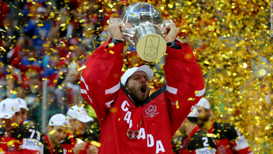 Goalie Mike Smith lifts the trophy Sunday, May 17, after Canada defeated Russia 6-1 in the gold-medal match of the Ice Hockey World Championship. The tournament was held in the Czech Republic.