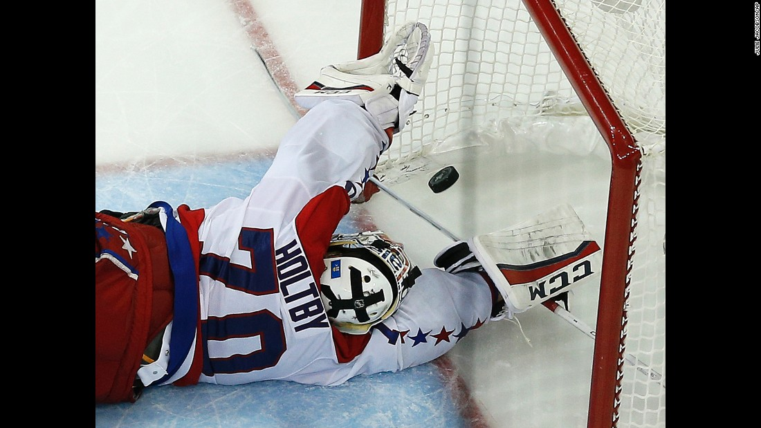 The puck gets by Washington goalie Braden Holtby on Wednesday, May 13, lifting the New York Rangers to a dramatic overtime win in Game 7 of the NHL's Eastern Conference semifinals. The series-winning goal was scored by the Rangers' Derek Stepan.