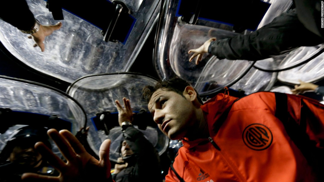 "River Plate striker Rodrigo Mora leaves the field under the protection of police shields after a match against rivals Boca Juniors was abandoned Friday, May 15, in Buenos Aires. The match was stopped because four River Plate players <a href=""http://www.cnn.com/2015/05/15/football/boca-juniors-river-plate-spray/"" target=""_blank"">were hit with pepper spray</a> as they came out for the second half. In the ensuing chaos, as many as 1,200 police officers were deployed to keep control of the opposing fans."
