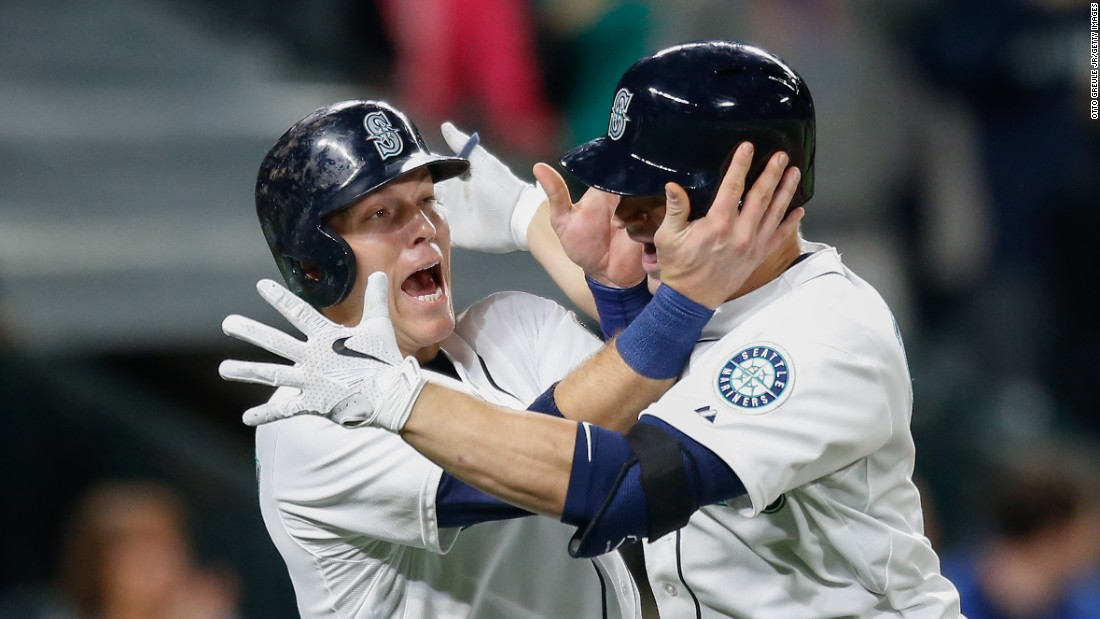 Seattle's Mike Zunino, right, is congratulated by teammate Logan Morrison after hitting a home run on Tuesday, May 12.