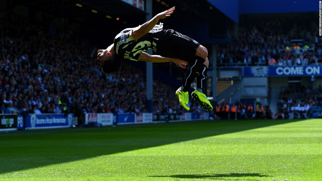 Newcastle's Emmanuel Riviere flips after scoring the opening goal in a Premier League match against Queens Park Rangers on Saturday, May 16. QPR came back to win the match 2-1 in London.
