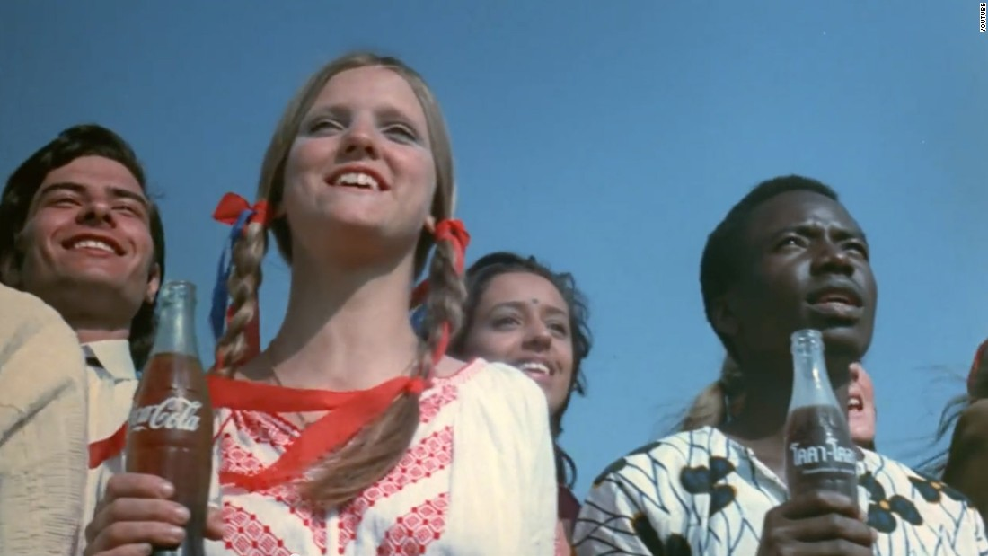 "In July 1971, the McCann Erickson advertising agency debuted its ""Hilltop"" spot for Coca-Cola and made advertising history. In the ad, young people from many nations sing that they'd ""like to buy the world a Coke and keep it company."" The song was commissioned for Coke but crossed over and became a bona fide pop hit: A version reached No. 7 on the Billboard Hot 100 chart on January 15, 1972."