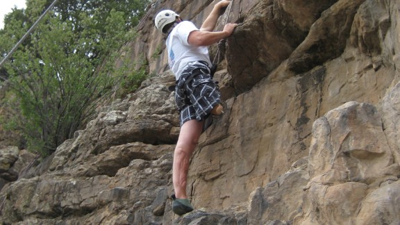 Murphy's recovery has been so successful, he's gone on to enjoy activities like rock climbing.