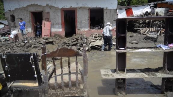 People in Salgar salvage their belongings.