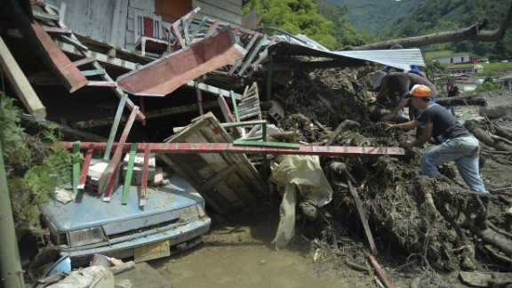 People search for relatives after the landslide.