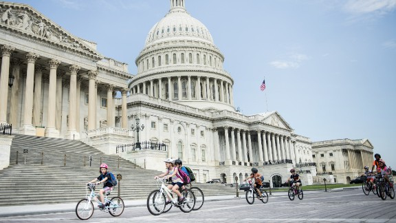 """Children ride bikes past the Capitol building in Washington, D.C. which topped the list as the """"Nation's Fittest City,"""" according to the annual American Fitness Index."""