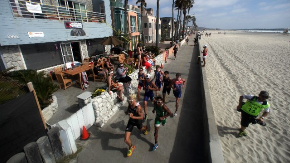 Competitors run on the boardwalk during a triathlon San Diego, ranked third on the list.