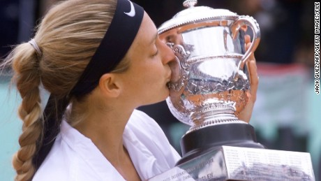 French Mary Pierce kisses the Suzanne Lenglen winner trophy after defeating Spanish Conchita Martinez in their women's singles final match, 10 June 2000 at the French Open in Roland Garros in Paris. Pierce won 6-2, 7-5. AFP PHOTO JACK GUEZ (Photo credit should read JACK GUEZ/AFP/Getty Images