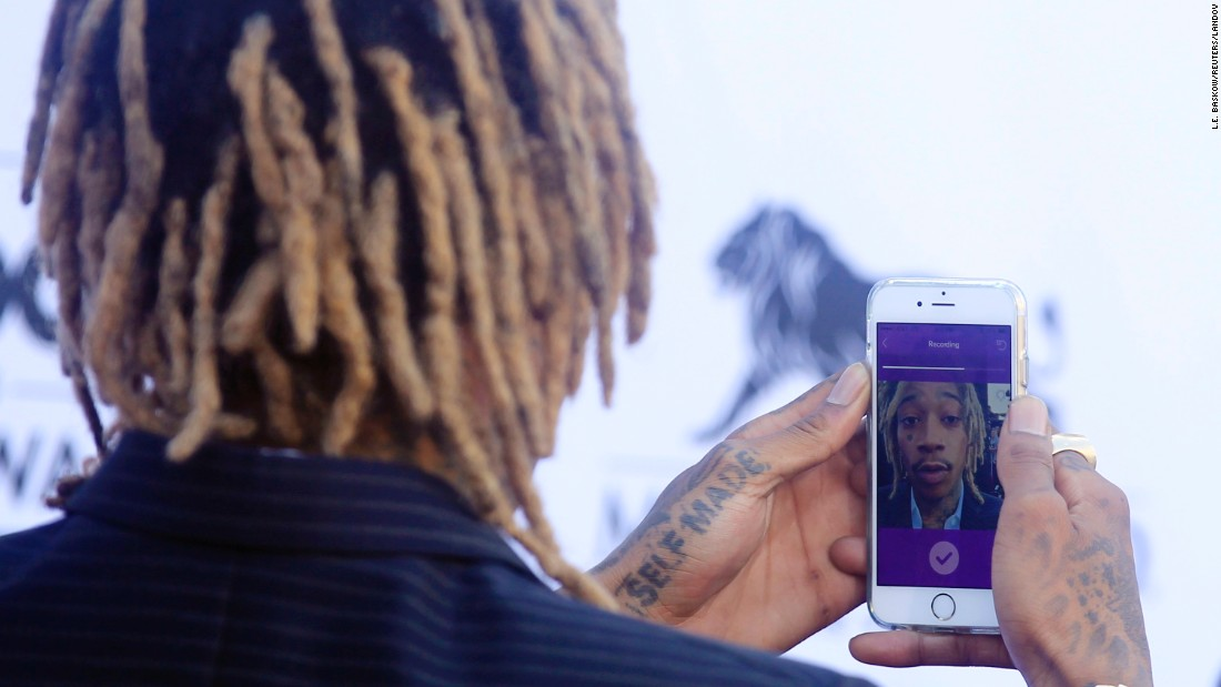 Rapper Wiz Khalifa takes a selfie Sunday, May 17, after arriving at the Billboard Music Awards in Las Vegas.