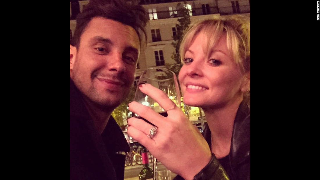 "Actress Kaitlin Doubleday takes a selfie with her boyfriend, Devin Lucien, after the two got engaged in Paris on Tuesday, May 12. ""Cheers!!!!!!!! To the most memorable night of my life thus far,"" <a href=""https://instagram.com/p/2mfDccNCDM/"" target=""_blank"">Doubleday wrote on Instagram,</a> showing off her new ring."