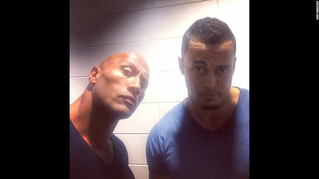 "Actor Dwayne Johnson, left, and baseball star Giancarlo Stanton show off the ""People's Eyebrow,"" a Johnson signature going back to his days as a pro wrestler. ""When brotha @giancarlo818 moonshots a 467ft bomb outta Dodgers Stadium we give the most appropriate response,"" <a href=""https://instagram.com/p/2ozQTkIh60/"" target=""_blank"">Johnson wrote on Instagram</a> on Wednesday, May 13."