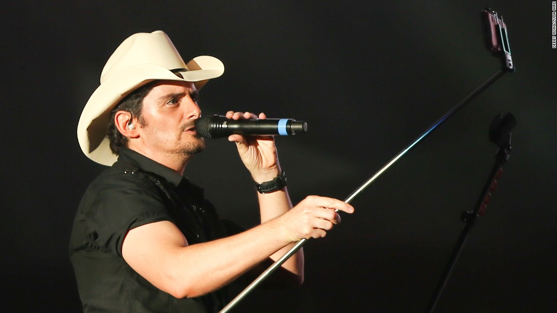 Country singer Brad Paisley uses a selfie stick Sunday, May 17, during the Shaky Boots music festival in Atlanta.