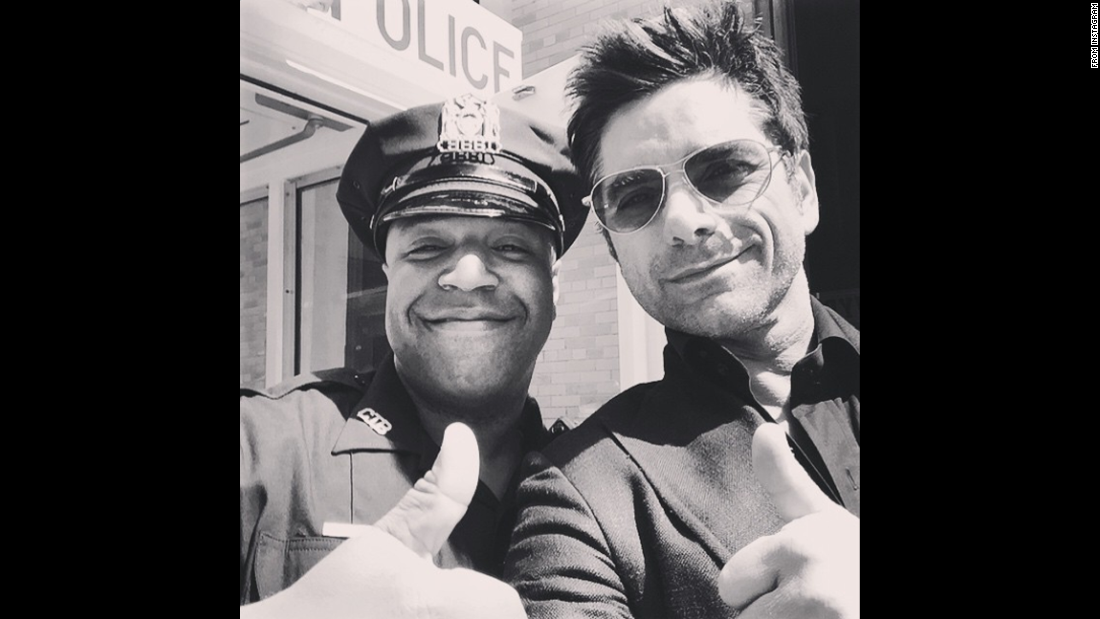 "Actor John Stamos, right, <a href=""https://instagram.com/p/2rOKJNih4X/"" target=""_blank"">gives the thumbs-up</a> in this selfie he posted with the caption ""NYPD #Rock"" on Thursday, May 14."