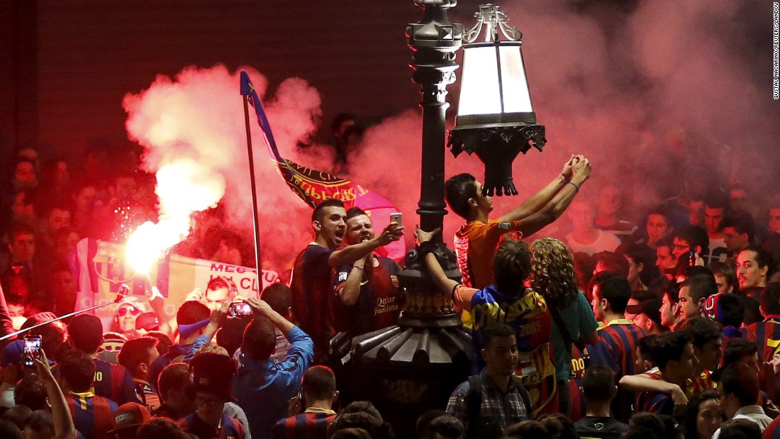 Supporters of the Spanish soccer club FC Barcelona celebrate their team's league title Sunday, May 17, in Barcelona.