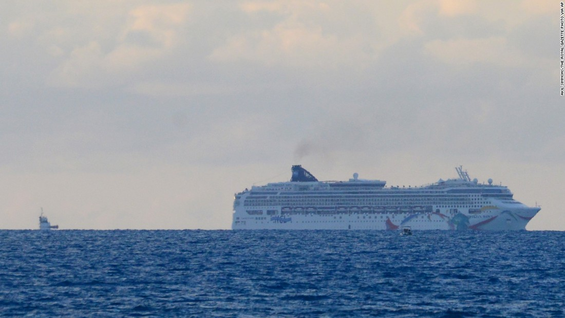 "The cruise ship Norwegian Dawn sits aground near Bermuda's North Channel on Tuesday, May 19. ""Norwegian Dawn temporarily lost power as the ship was departing King's Wharf, Bermuda. The ship's propulsion was affected and, at which time, the vessel made contact with the channel bed. All guests and crew are safe,"" spokeswoman Vanessa Picariello said."