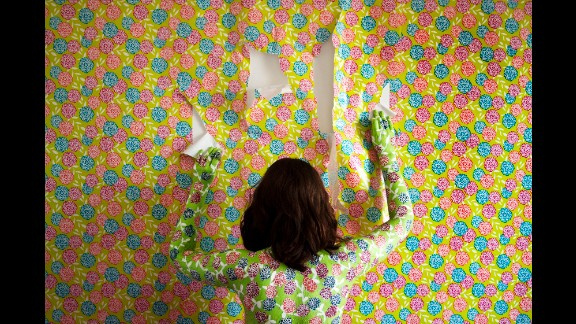 A woman matches her wallpaper in this photo from Keyana Tahmaseb