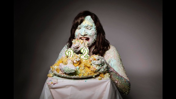"""Tahmaseb used cake for this self-portrait on her 22nd birthday. """"Every year I take a self-portrait on my birthday,"""" she said, """"and this particular year (2014), I wanted it to do with my project. ... I covered myself in frosting. This image also has to do with my fear of growing older."""""""