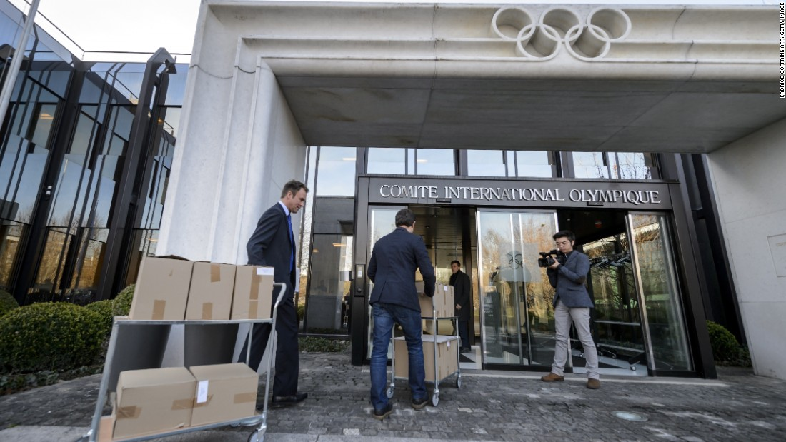 Staff carry the 2022 Winter Olympic bid files of Almaty, Kazakhstan on January 6, 2015 at the International Olympic Committee headquarters in Lausanne, Switzerland. The IOC will make a final decision in July 2015. Kazakhstan is also planning to bid for football's 2026 World Cup.