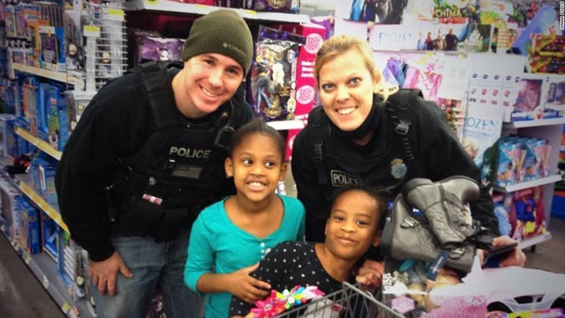 "Orozco was active in her community. Here she participates with her police department's ""Shop with a Cop"" program."