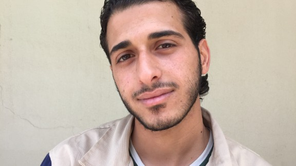 "Mohammad Altouma, 22. First-year university student, studying mechanical aviation engineering. ""The town square in my village was bombed by the regime. It hit my uncle's house. I rescued my aunt, uncle and 5-year-old girl cousin, but her two brothers were killed."""