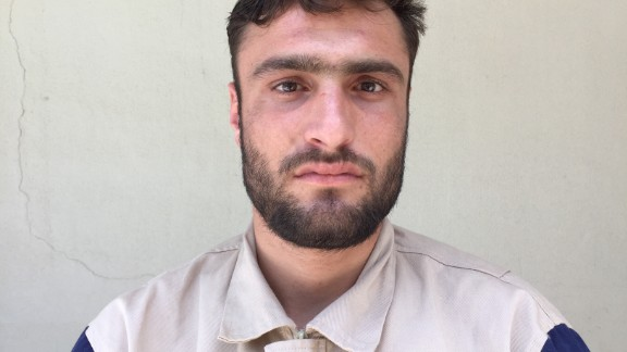 """Siraj Aldeen Hassoun, 25. Construction. """"There was a bombing in Sarmin. The roof of the second floor of a two-story building collapsed. I shouted, 'Is anybody here?' I heard movement, and found a man in a safe space, thanks to two big rocks on either side of him."""""""
