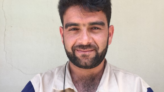 "Bilal Salloum, 29. Syrian Secret Service. ""My whole village used to leave during the day and only come home at night to sleep. There was this old married couple, whose home was hit with a barrel bomb. They both lived, we saved them, and took them to the hospital."""
