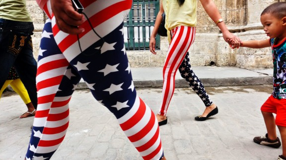Women wearing pants designed with the colors of the U.S. flag walk through Old Havana in Cuba in January. Many Cubans say displaying U.S. flags makes them no less patriotic about their own country, according to Patrick Oppmann, CNN's correspondent in Cuba. They have relatives in the States and a positive opinion of their neighbor to the north despite the antagonism between the U.S. and Cuban governments.