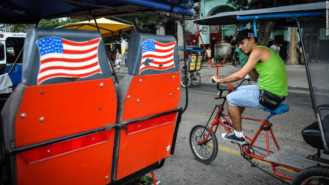 American flags adorn a pedicab in Havana in January.