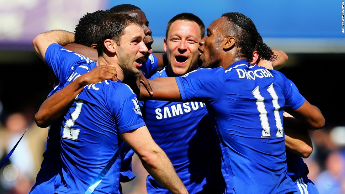 Chelsea's players celebrating after securing the 2014-15 EPL title with a 1-0 home win over Crystal Palace.