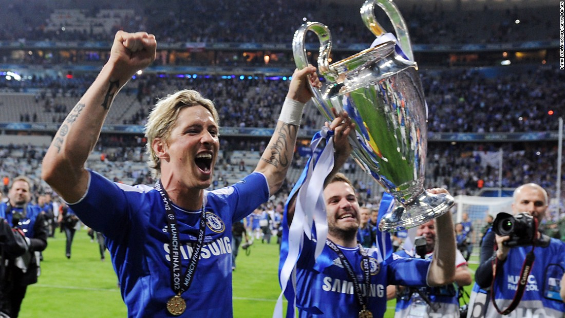 The match finished 1-1 after extra-time, with striker Didier Drogba scoring the winning penalty in the shootout. Here, Spaniards Fernando Torres (left) and Juan Mata celebrate with the trophy. Both have since left the club.