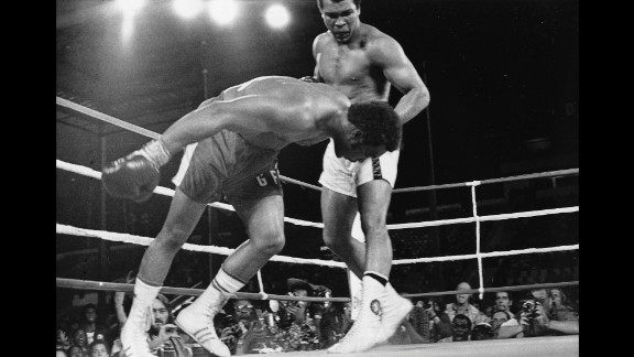 Muhammad Ali watches heavyweight champion George Foreman fall to the canvas during their title bout in Kinshasa, Zaire, in October 1974. Ali