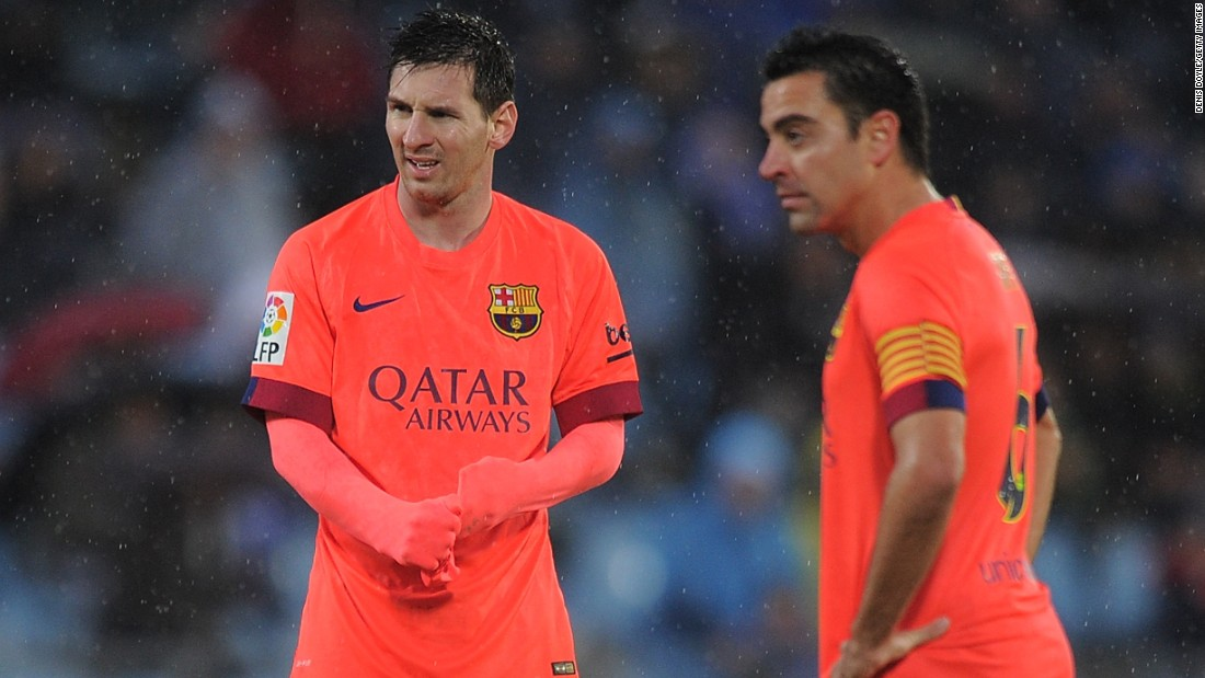 Lionel Messi and Xavi Hernandez weigh up their options during a match at Getafe in 2014.