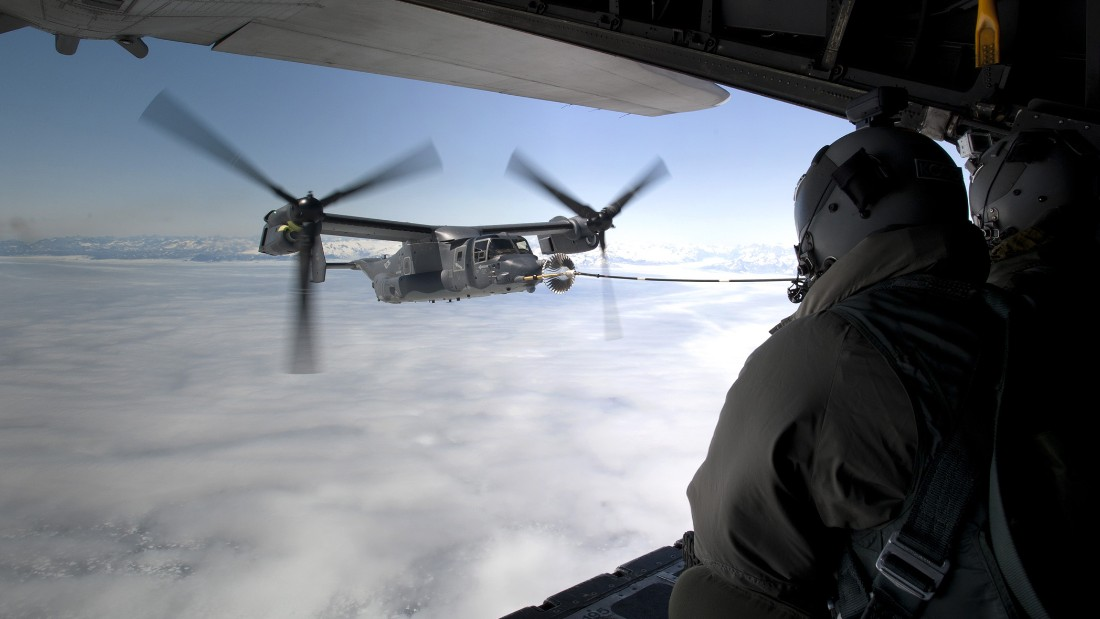A CV-22B Osprey receives fuel from an MC-130H Combat Talon II on June 21, 2013, off the coast of Greenland.